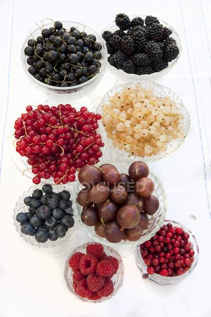Summer berries in glass bowls — Stock Photo