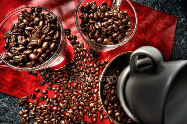 Coffee beans in glass cups — Stock Photo