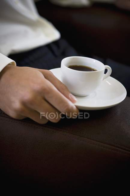Man holding espresso cup — Stock Photo