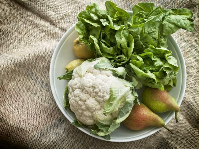 Cauliflower with pears and salad — Stock Photo