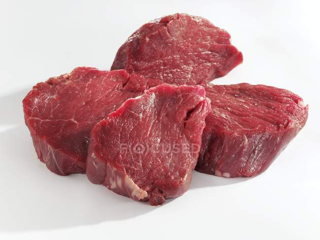 Raw slices of beef fillet — Stock Photo