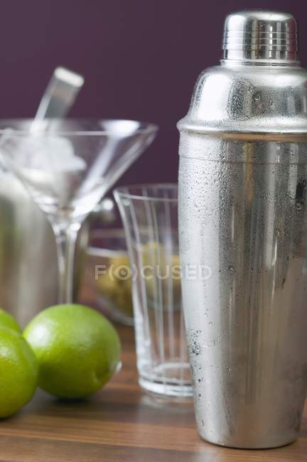Cocktail shaker on wooden table — Stock Photo