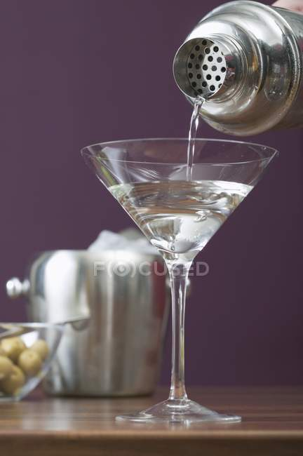Pouring Martini out — Stock Photo
