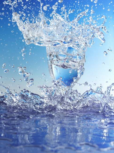 Water splashing out of glass — Stock Photo