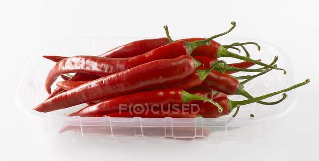 Chillies in plastic tray — Stock Photo