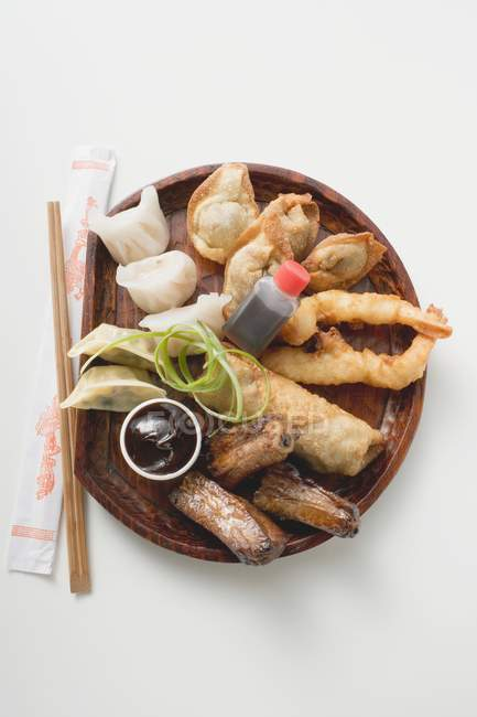 Plate of Asian appetisers — Stock Photo