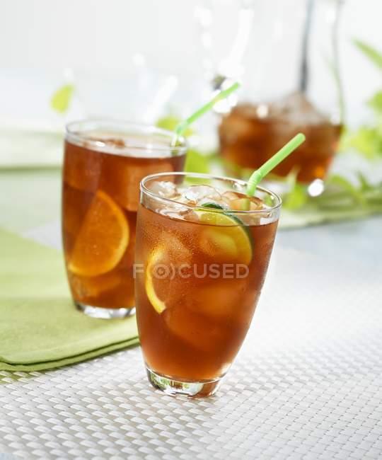 Iced tea with lemons and limes — Stock Photo