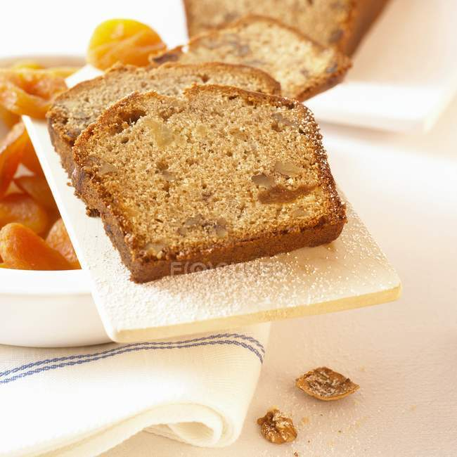 Closeup view of apricot and nut sliced loaf — Stock Photo