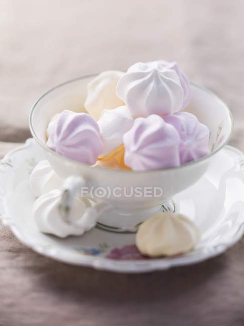 Various coloured meringues in a cup — Stock Photo