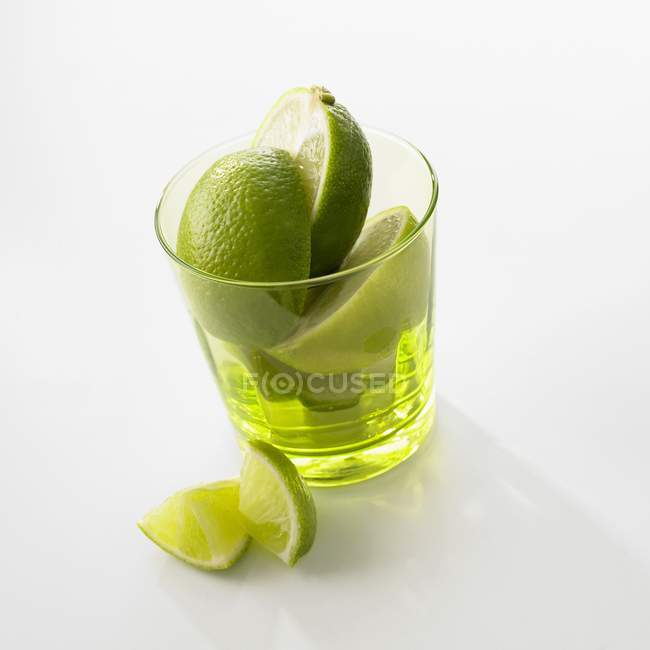 Sliced Limes in glass — Stock Photo