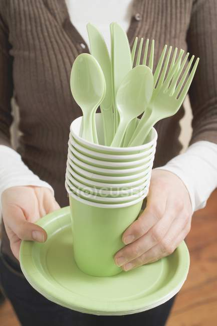 Cropped view of woman holding picnicware — Stock Photo