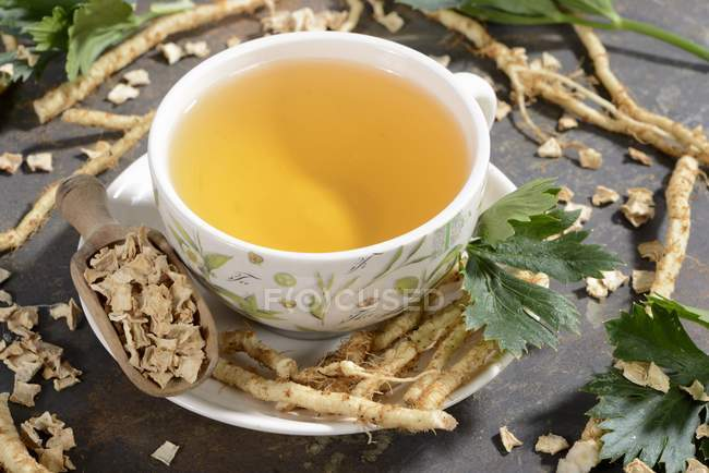 Cup of parley root tea — Stock Photo