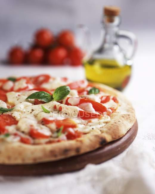 Pizza Margherita with basil — Stock Photo