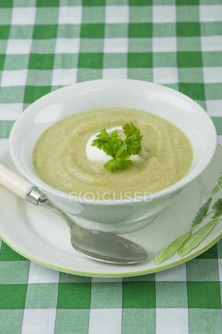 Celery soup with creme fraiche — Stock Photo