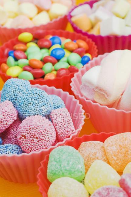 Assortment of sweets in bowls — Stock Photo