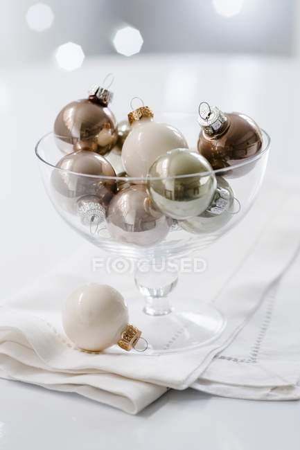 Christmas tree baubles in glass dish — Stock Photo
