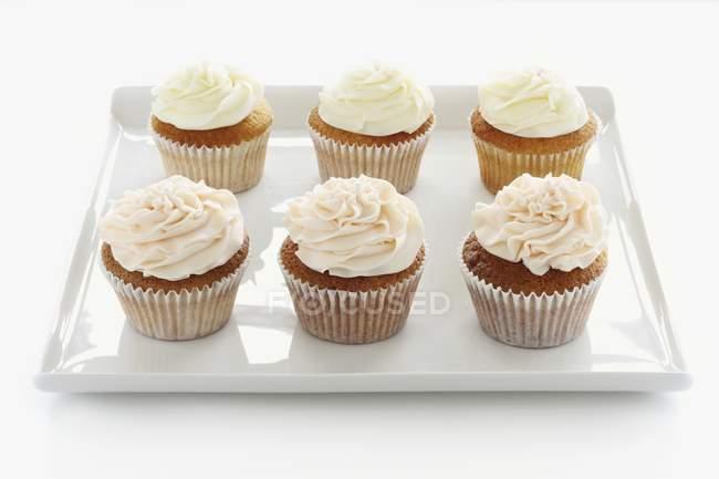 Seis cupcakes buttercream — Fotografia de Stock