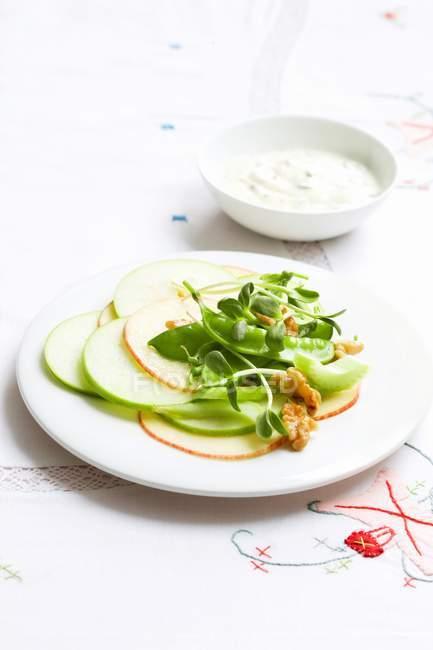 Waldorf salad with sugar snap peas on white plate — Stock Photo