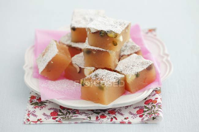 Closeup view of homemade lokum with pistachios and icing sugar — Stock Photo
