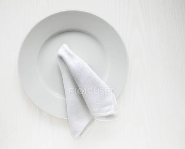 Top view of a white plate and a serviette — Stock Photo