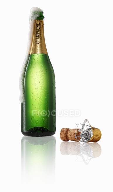 Champagne bubbling out of the bottle — Stock Photo
