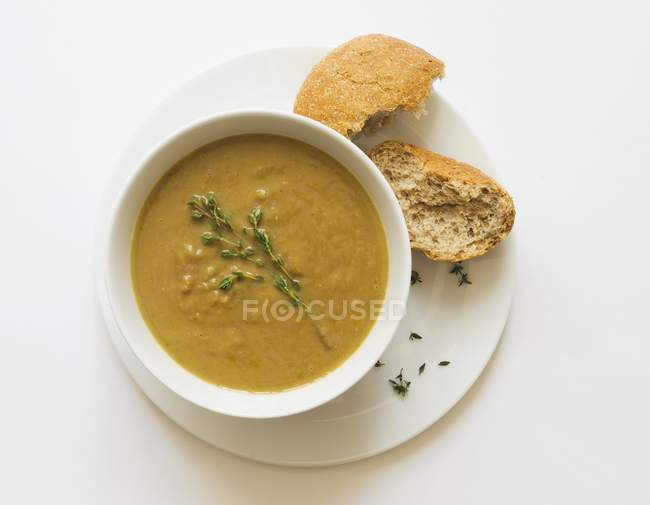 Bowl of vegetable soup with thyme — Stock Photo