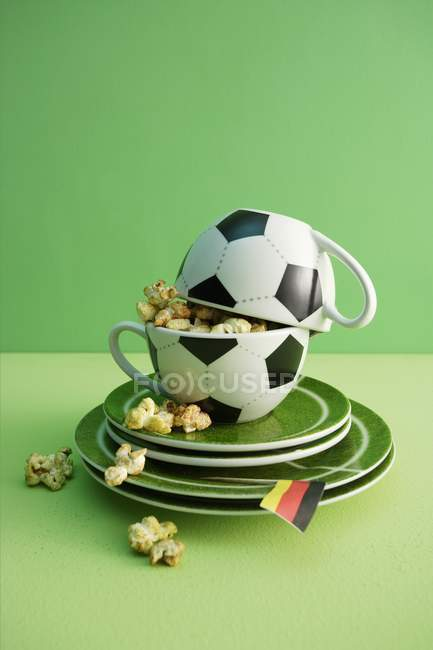 Football cups with popcorn — Stock Photo