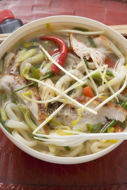 Asian spicy noodle soup — Stock Photo