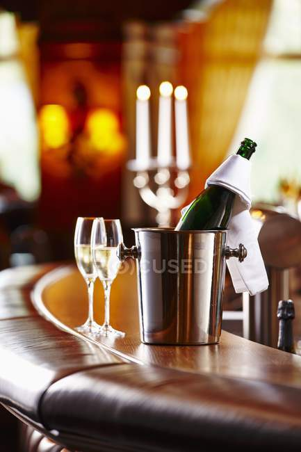 Bottle of champagne and champagne glasses — Stock Photo