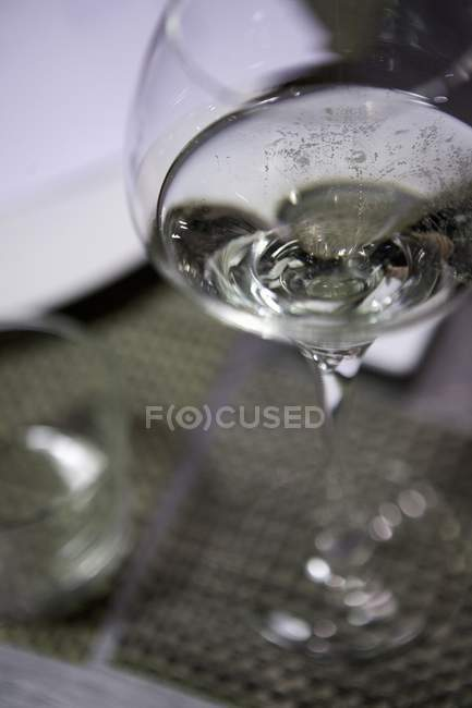 Closeup view of a wine glass on a coaster — Stock Photo