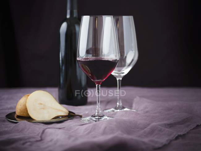 Glass of Bordeaux Wine with Halved Pear — Stock Photo