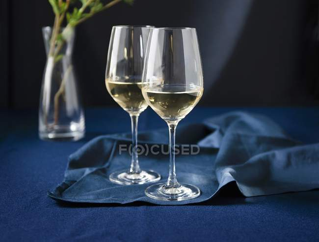 Glasses of White Wine on Blue — Stock Photo