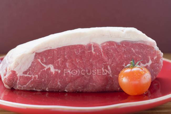 Fresh beef and cherry tomato — Stock Photo