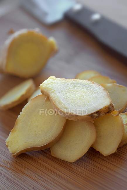 Fresh sliced ginger root — Stock Photo