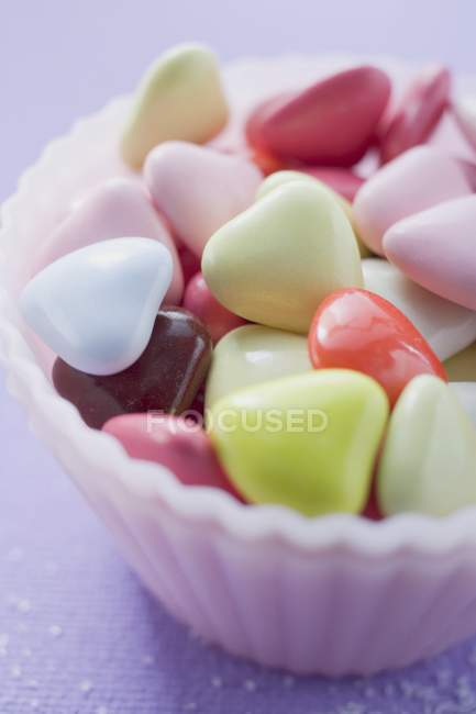 Closeup view of colored hearts in small pink dish — Stock Photo