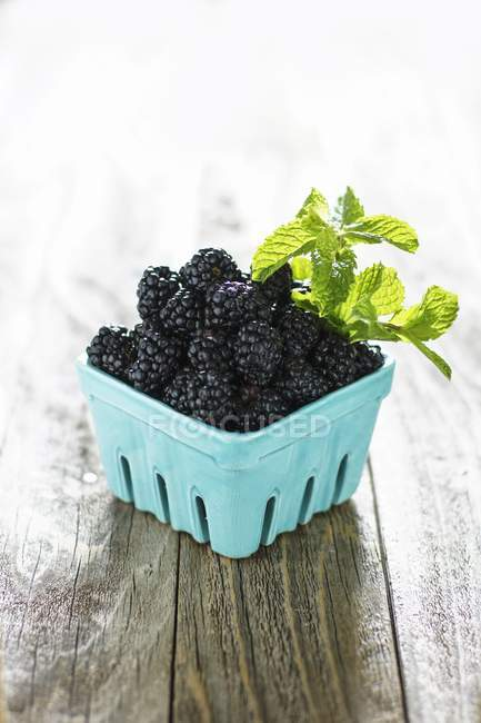 Blackberries in cardboard container — Stock Photo
