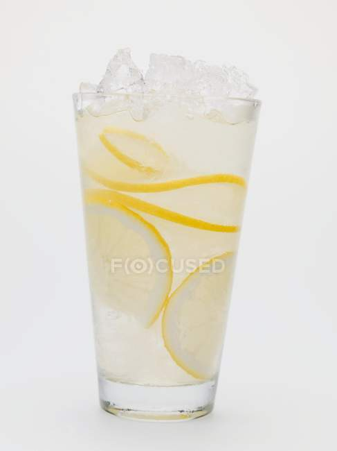 Glass of lemonade with crushed ice — Stock Photo