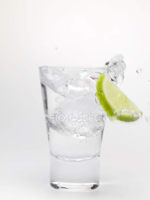 Water splashing out of a glass — Stock Photo