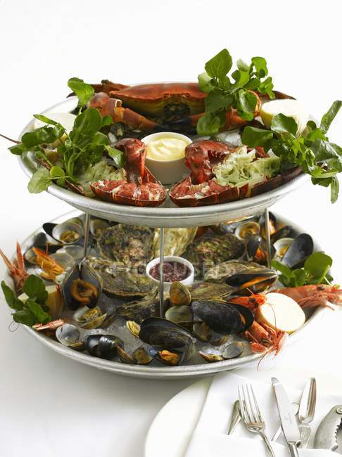 Seafood platter with dips and salad — Stock Photo