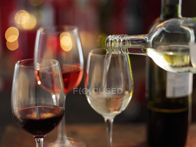 Pouring Wine into glass — Stock Photo