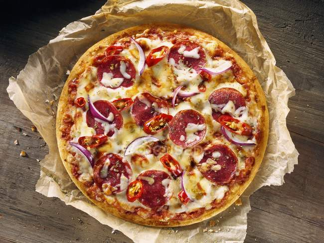 Salami pizza with onions — Stock Photo