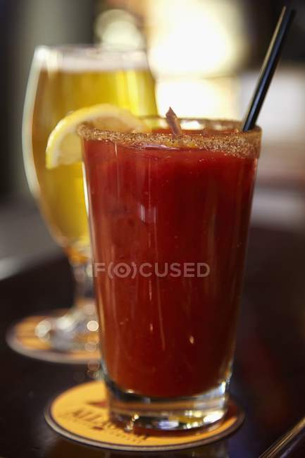 Closeup view of Bloody Mary cocktail and a glass of beer — Stock Photo