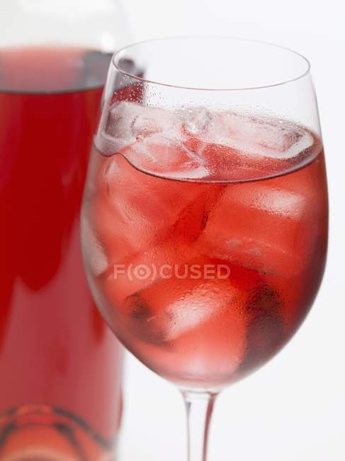 Glass of rose wine with ice cubes — Stock Photo