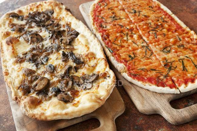 Two Pizzas on Boards — Stock Photo