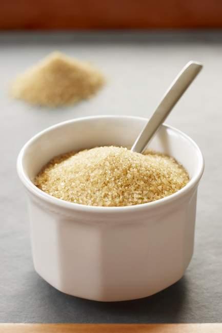Brown sugar in small bowl — Stock Photo