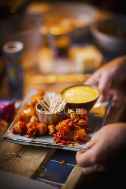Potatoes marinated in sauce — Stock Photo