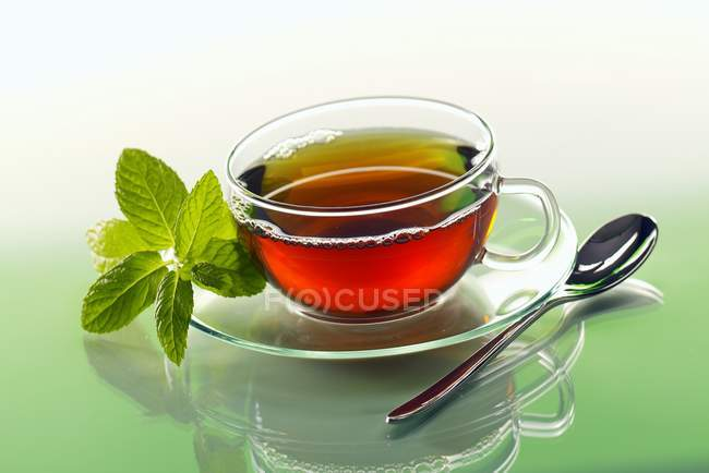 Peppermint tea in glass cup — Stock Photo