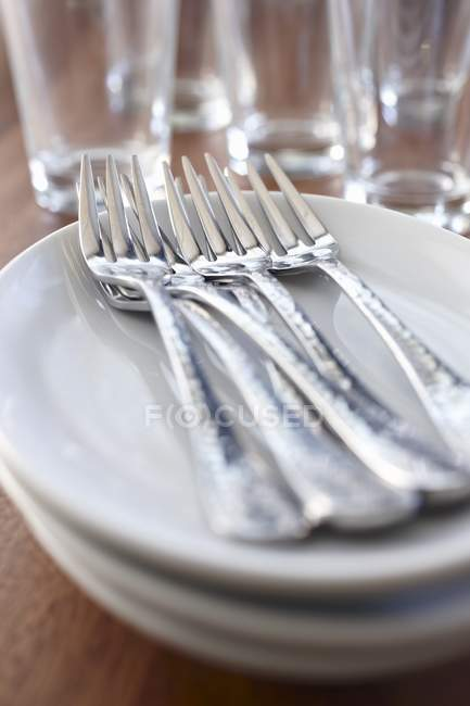 Forks on a stack of plates — Stock Photo