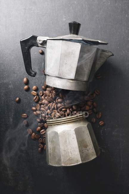 Closeup view of coffee beans in disassembled vintage Espresso maker — Stock Photo