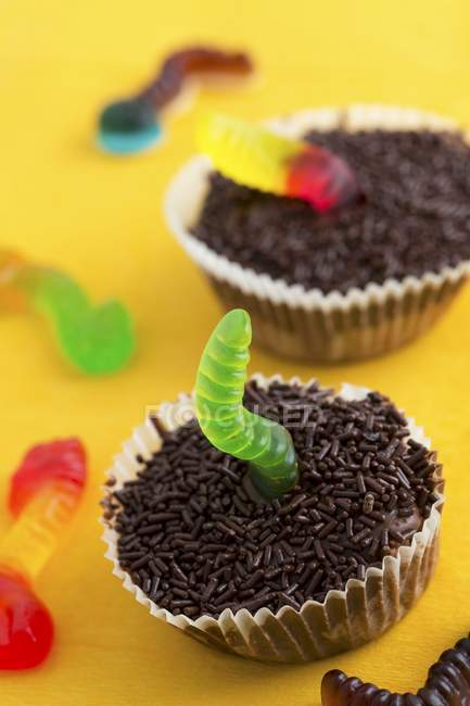 Cupcakes decorated with jelly worms — Stock Photo